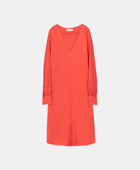 Long sleeved dress in orange silk blend.