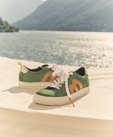 Green suede sneakers with contrasting colour logo